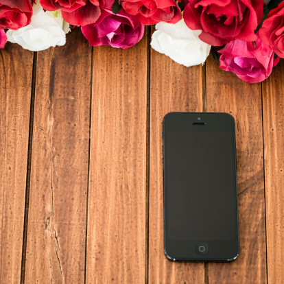 Iphone 5 On Wood Plank Table With Rose Flower Stock Photo - Download Image Now