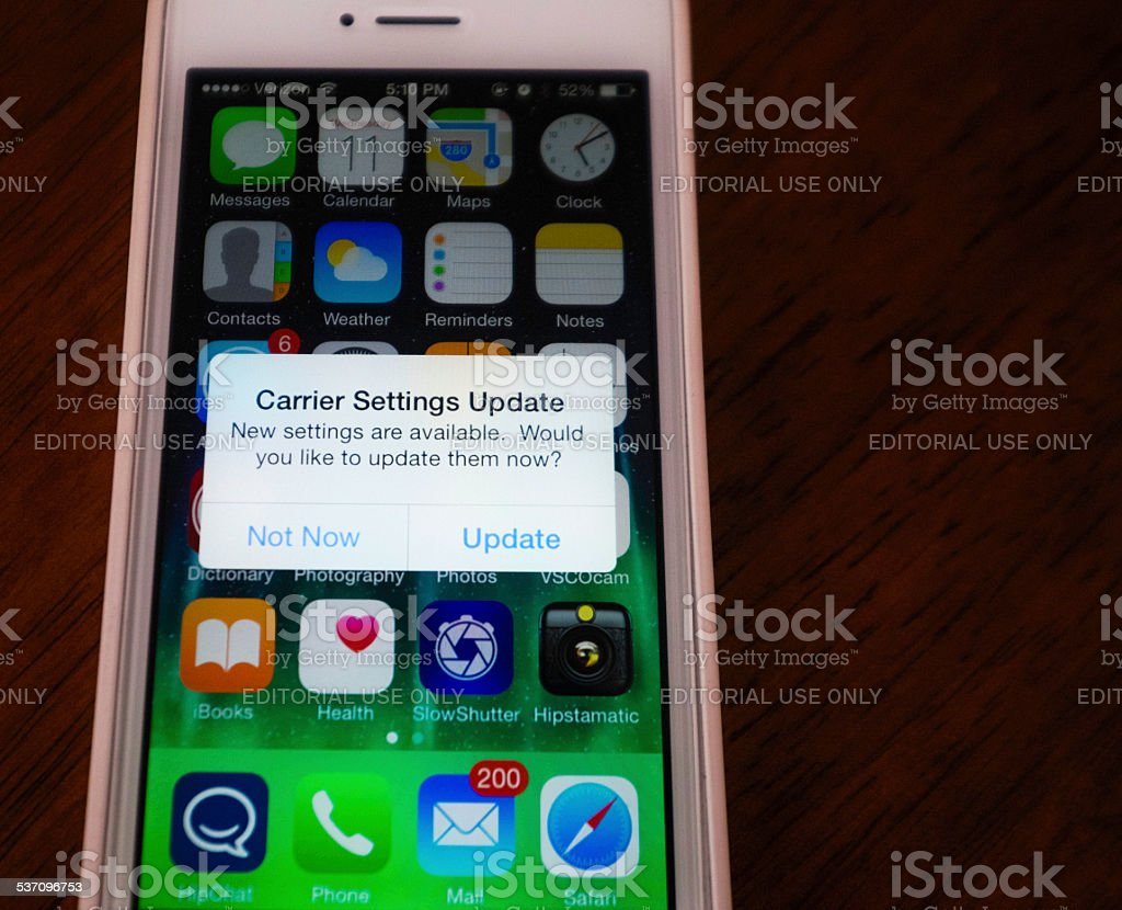 iPhone 5 with Carrier Settings Update Message stock photo