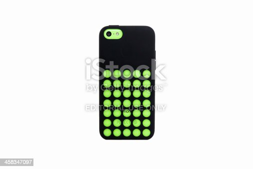 Stuttgart, Germany - October 4, 2013: Apple iPhone 5C in the lime green color version with original Apple 5C Case in black color isolated on white background.