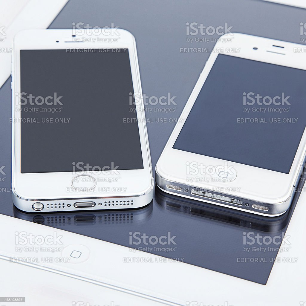 iPhone 5s, 4s and iPad stock photo