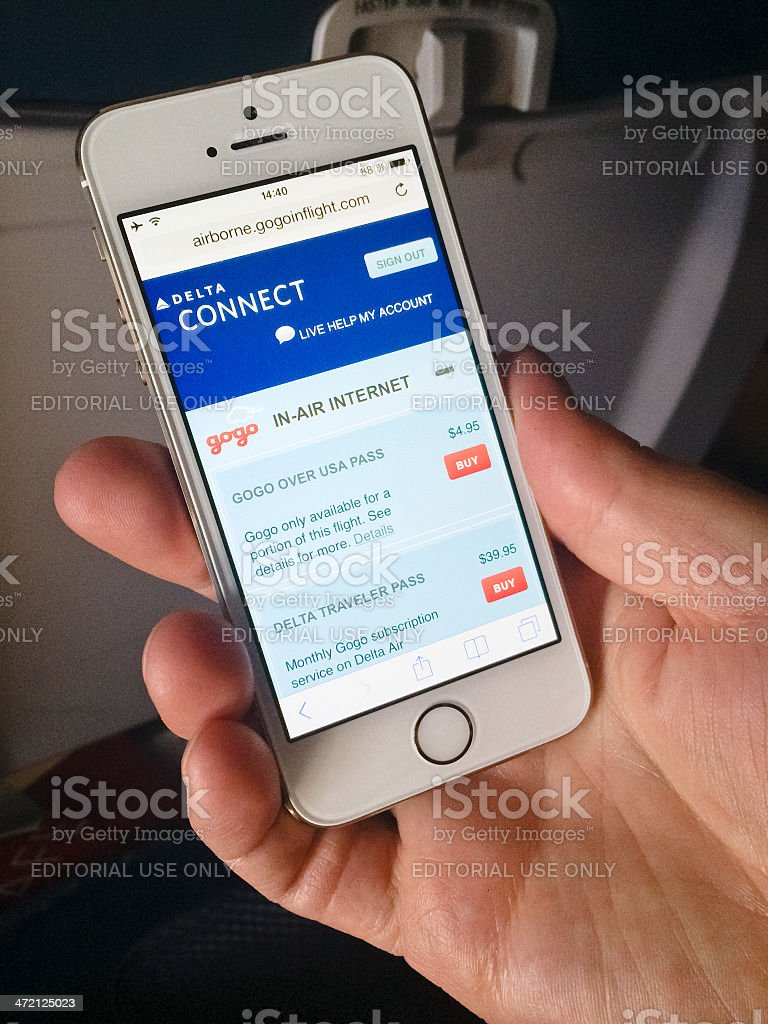 iPhone 5s connecting to the Internet during flight stock photo