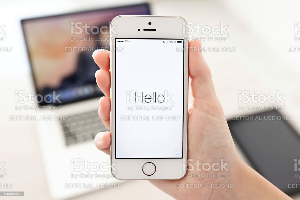 iPhone 5S in hand with window activation when installing IOS8 stock photo