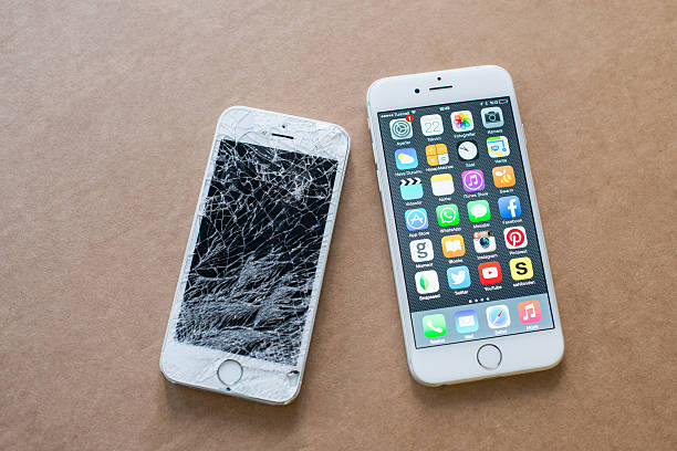 iPhone 6 and broken iPhone 5s stock photo