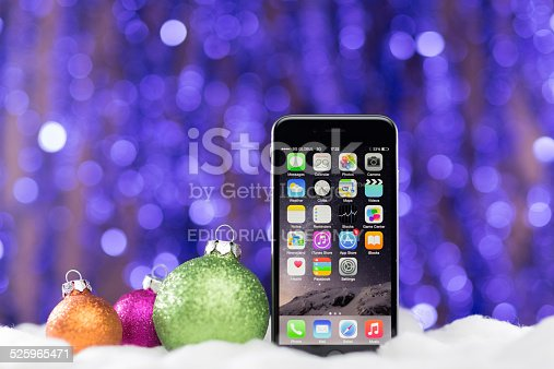 Sofia,Bulgaria - November 29, 2014: Apple Space Gray iPhone 6 at sparkling Christmas bokeh background,displaying home page.This is the newest product of Apple with IOS 8 and higher resolution 4.7 inch screen, released on September 9,2014.