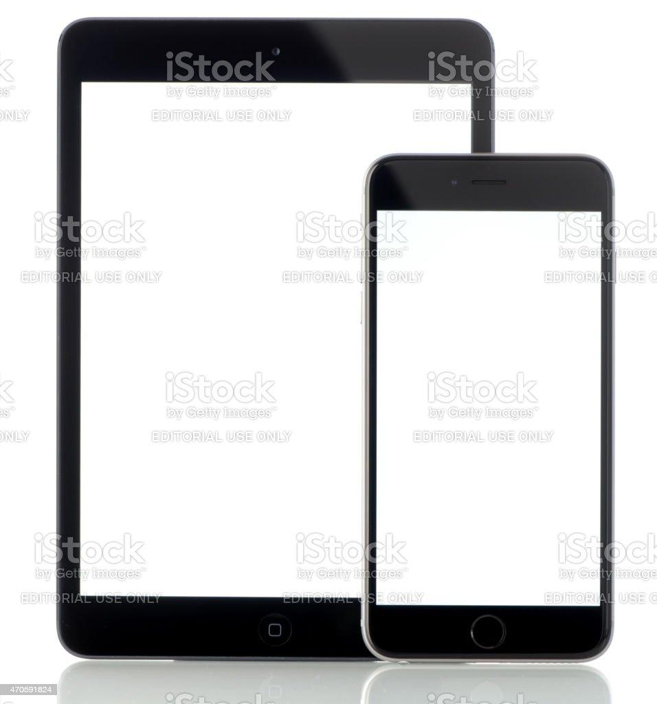 iPhone 6 Plus and iPad Mini displaying blank white screen stock photo
