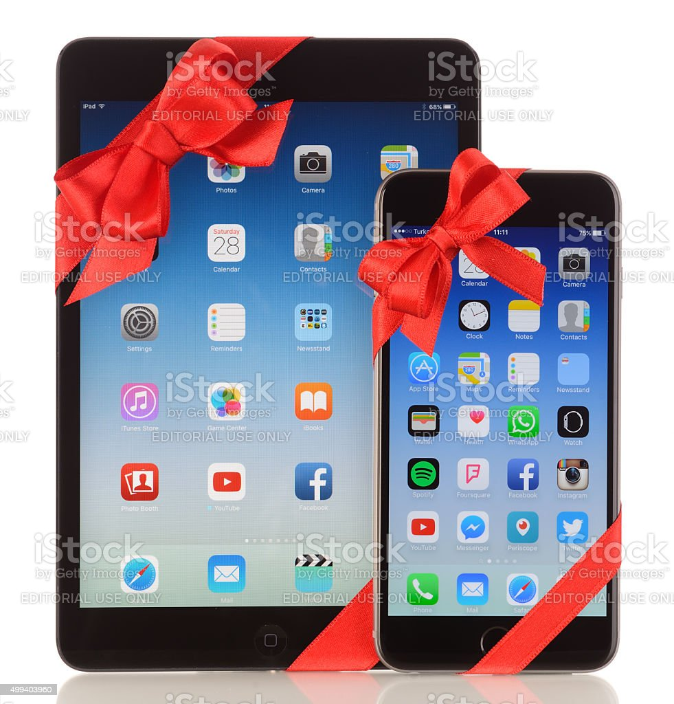 iPhone 6 Plus and iPad Mini with red ribbon stock photo