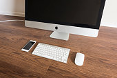 iPhone 6s placed next to iMac 27inch