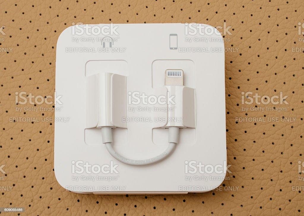 iPhone 7 plus unboxing Lightning to 3.5 mm Headphone stock photo