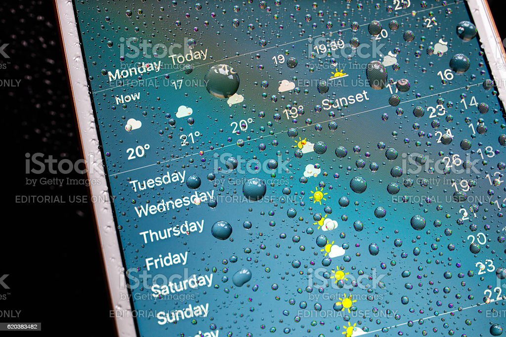 iPhone 7 Plus waterproof weekly weather forecast on display stock photo