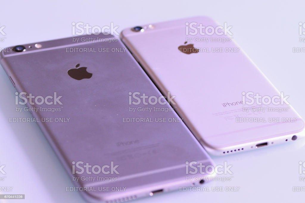 iPhone Standard & Plus models on desk in horizontal frame