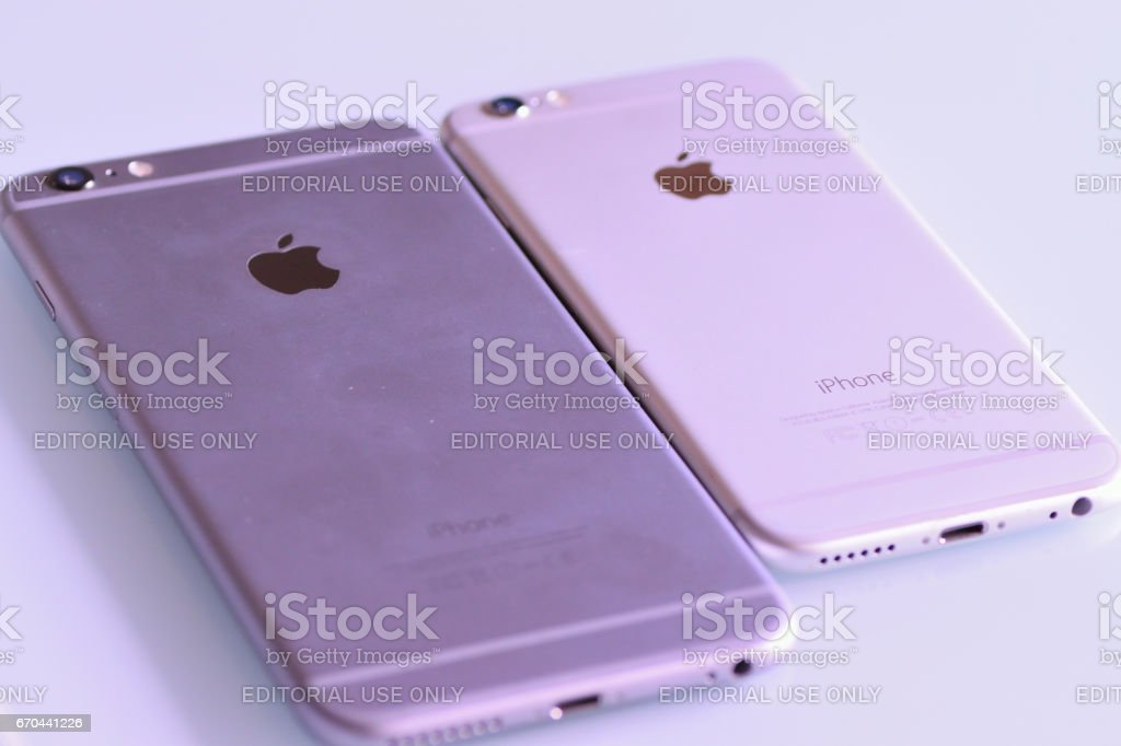 iPhone Standard & Plus models on desk in horizontal frame stock photo
