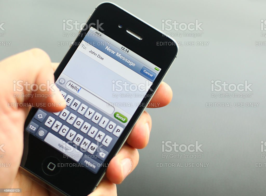 iPhone texting royalty-free stock photo