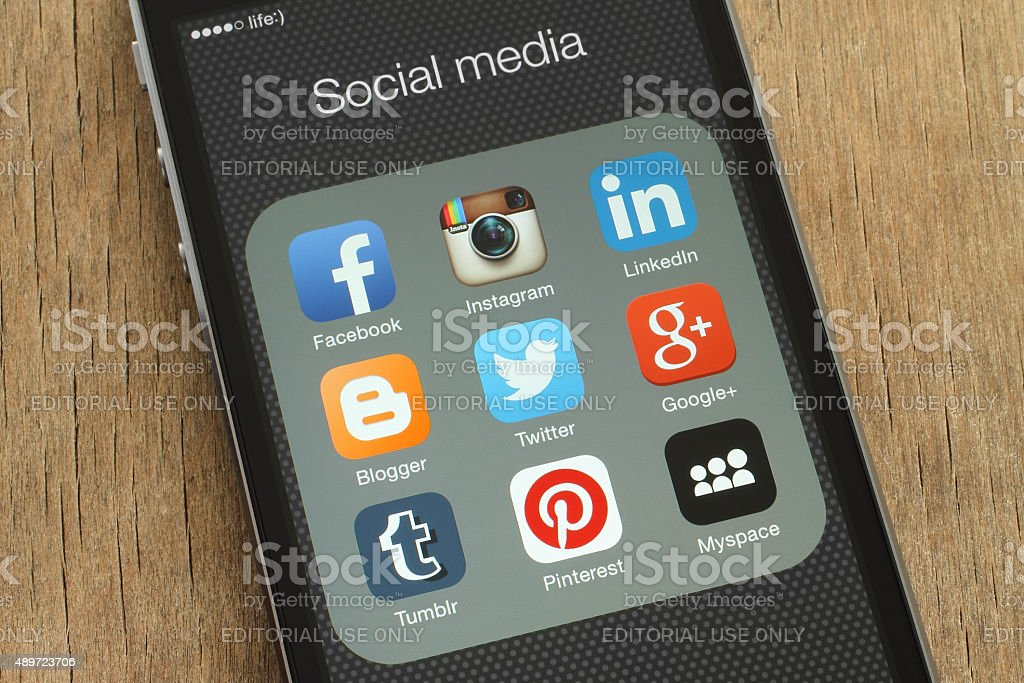 iPhone with popular social media icons on its screen stock photo