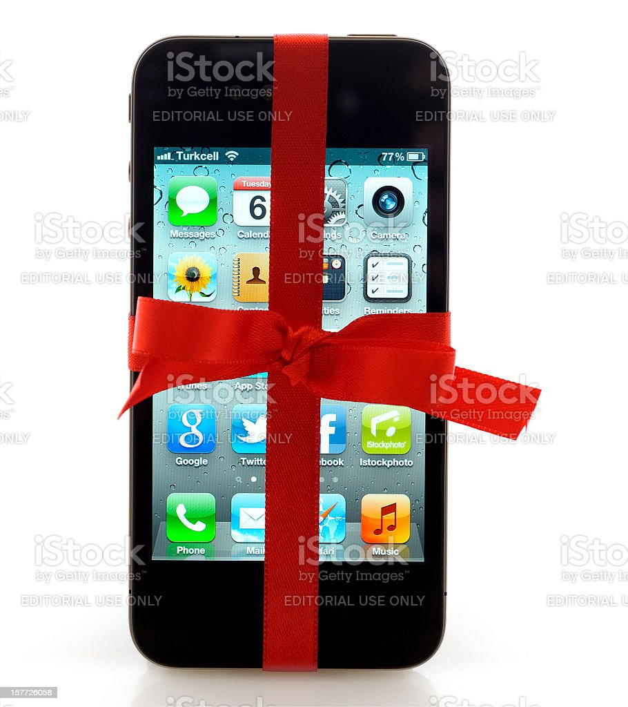 iPhone with red ribbon stock photo