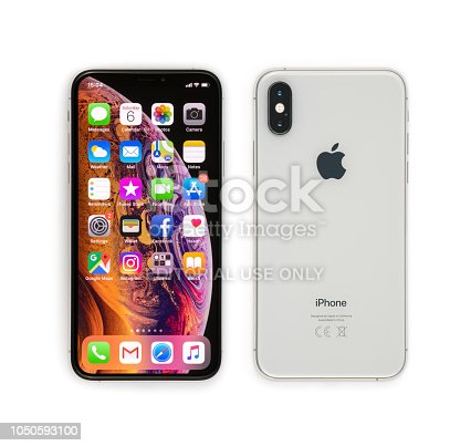 Celje, Slovenia - October 06, 2018: Front and back side of iPhone XS smartphone with 5.8 inch Retina display, silver color version with 256 GB memory, isolated on white.
