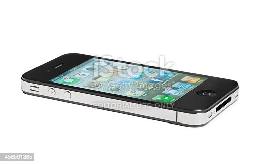 Dublin, Ireland - March 9, 2011: Iphone4, one of Apple's most succesful products,  lying down flat on a white surface with the screen turned on.