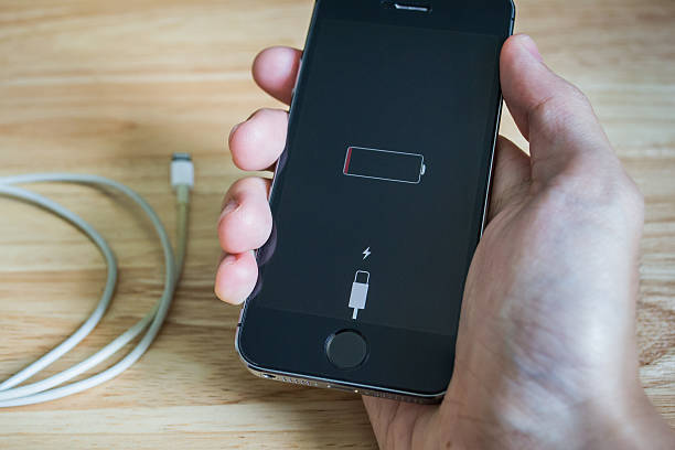 iPhone's battery is running out stock photo