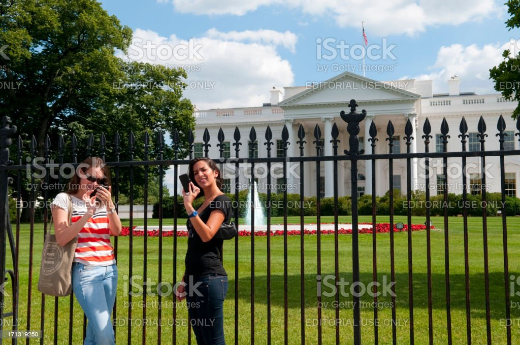 iPhone-wielding tourists at White House royalty-free stock photo