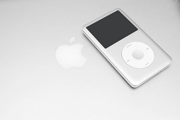 iPod classic 160 Gb on silver macbook Pavlograd, Ukraine - December 18, 2014: iPod classic 160 Gb on silver macbook. Studio shot. mp3 player stock pictures, royalty-free photos & images