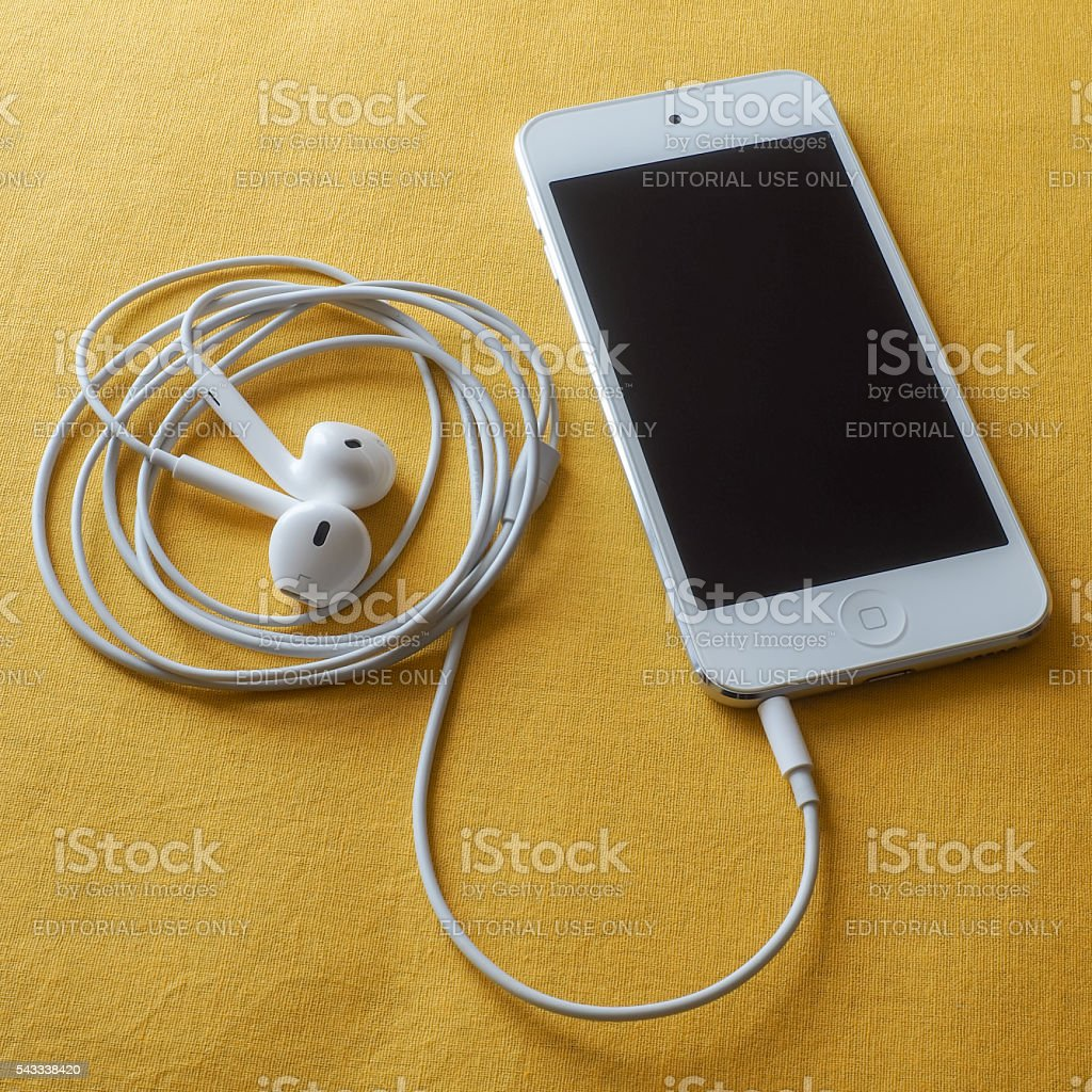 iPod Touch on Yellow Background stock photo