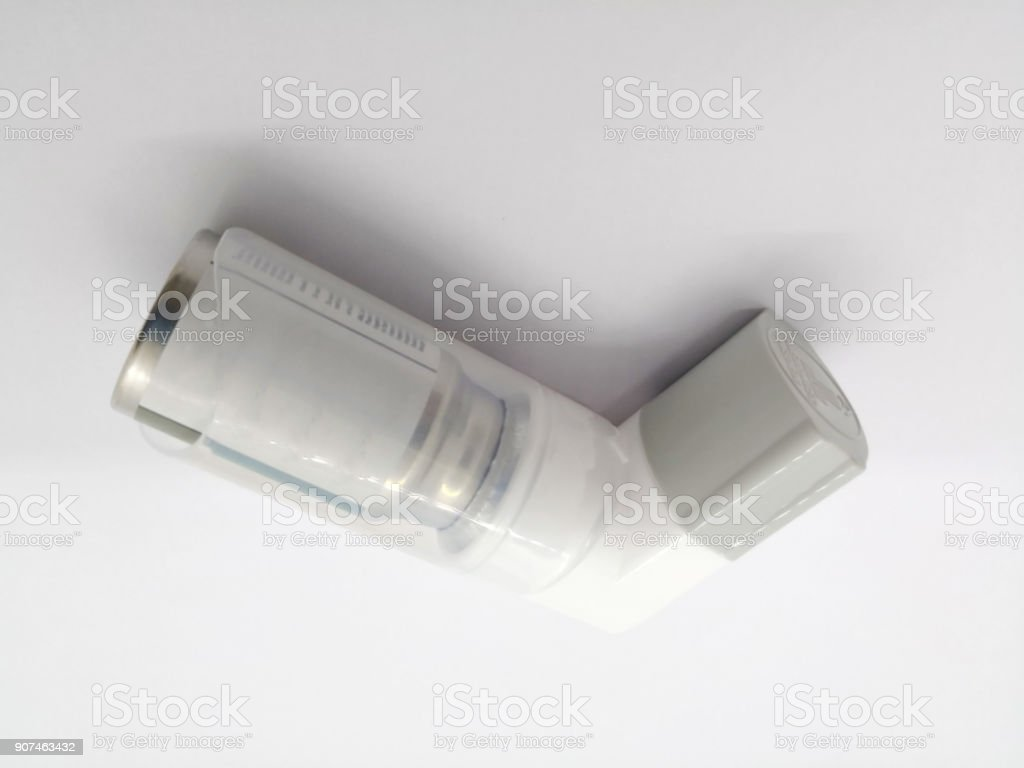 Ipratropium and Fenoterol metered aerosol, that is oral steroid inhaler. Bronchodilator for the prevention & treatment of symptoms in chronic obstructive airway disorders. isolated on white background and copy space. stock photo