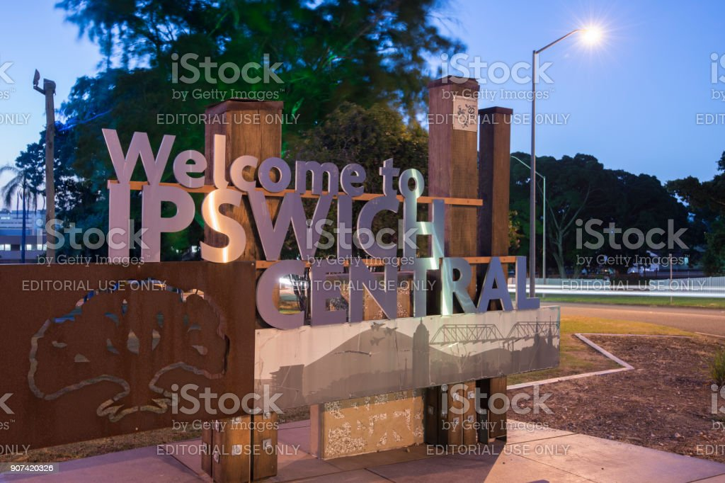 Ipswich, Australia - Tuesday 16th January 2018: View of the Ipswich City welcome sign and traffic at night on Tuesday 16th January 2018. stock photo
