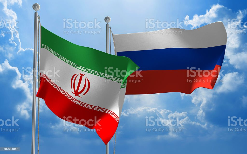Iran and Russia flags flying together for diplomatic talks stock photo