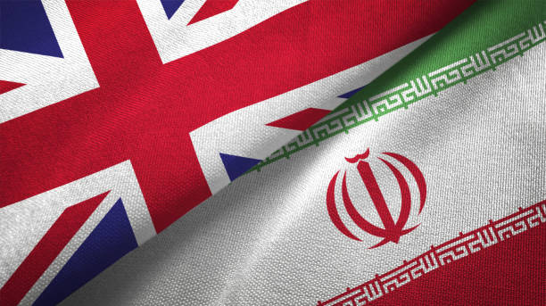 Iran and United Kingdom two flags together realations textile cloth fabric texture Iran and United Kingdom flag together realtions textile cloth fabric texture iran stock pictures, royalty-free photos & images