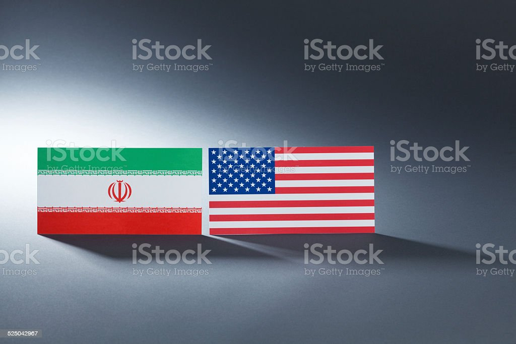 Iran and United States Flags with Long Gray Shadows Hz stock photo