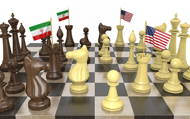 Iran and United States foreign policy strategy and power struggle Foreign policy strategy concept of a chess board with rooks carrying national flags for Iran and the United States. foreign affairs stock pictures, royalty-free photos & images