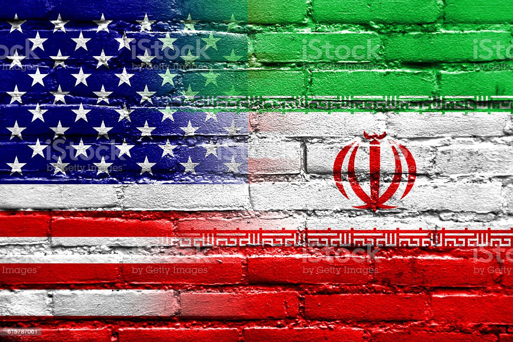 Iran and USA Flag painted on brick wall stock photo