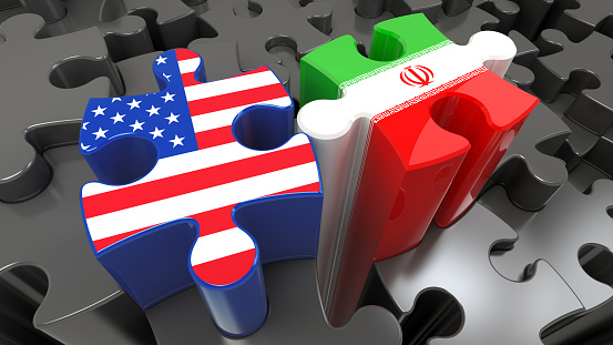 istock Iran and USA flags on puzzle pieces. 961938950