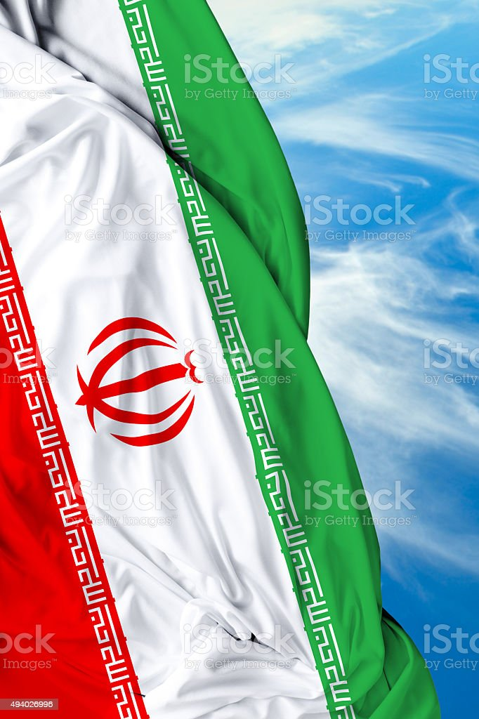 Iran waving flag on beautiful day stock photo
