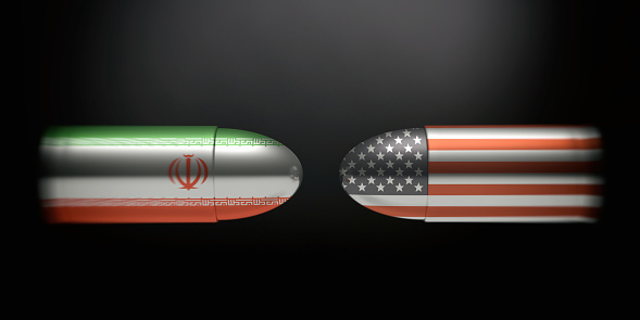 istock Iranian and American flags on bullets, black background. 3d illustration 1043434600