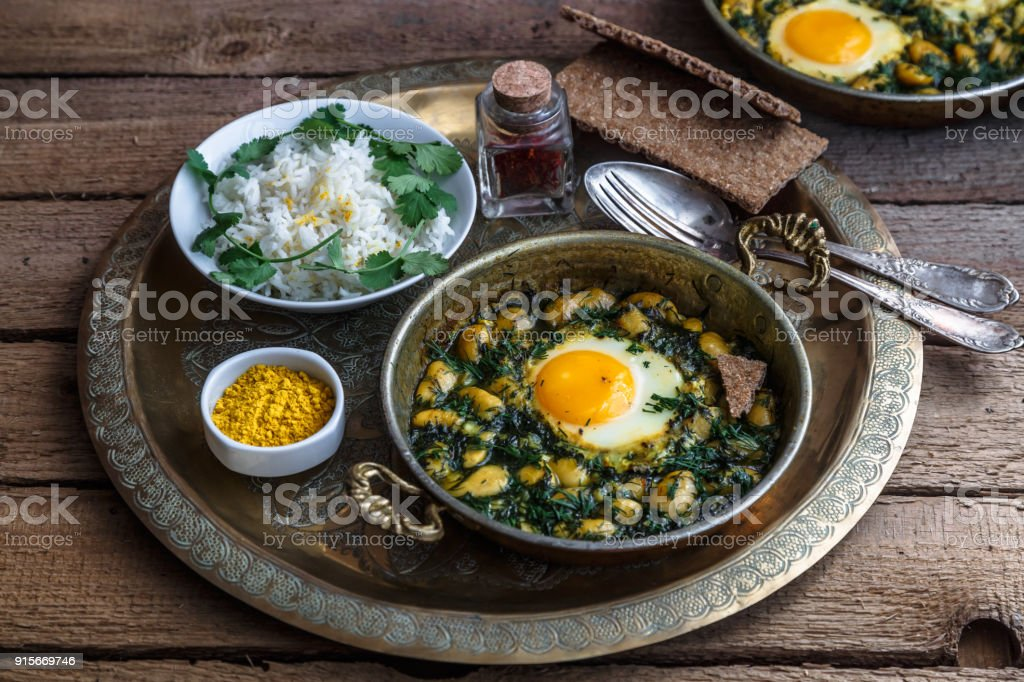 Iranian breakfast made with eggs, bean and dill stock photo