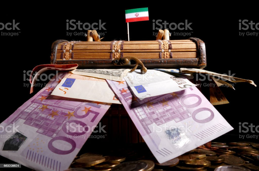 Iranian flag on top of crate full of money stock photo