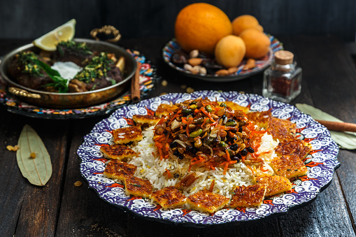 istock Iranian sweet rice with orange zest, nuts and dried fruits, shirin polo 932450748