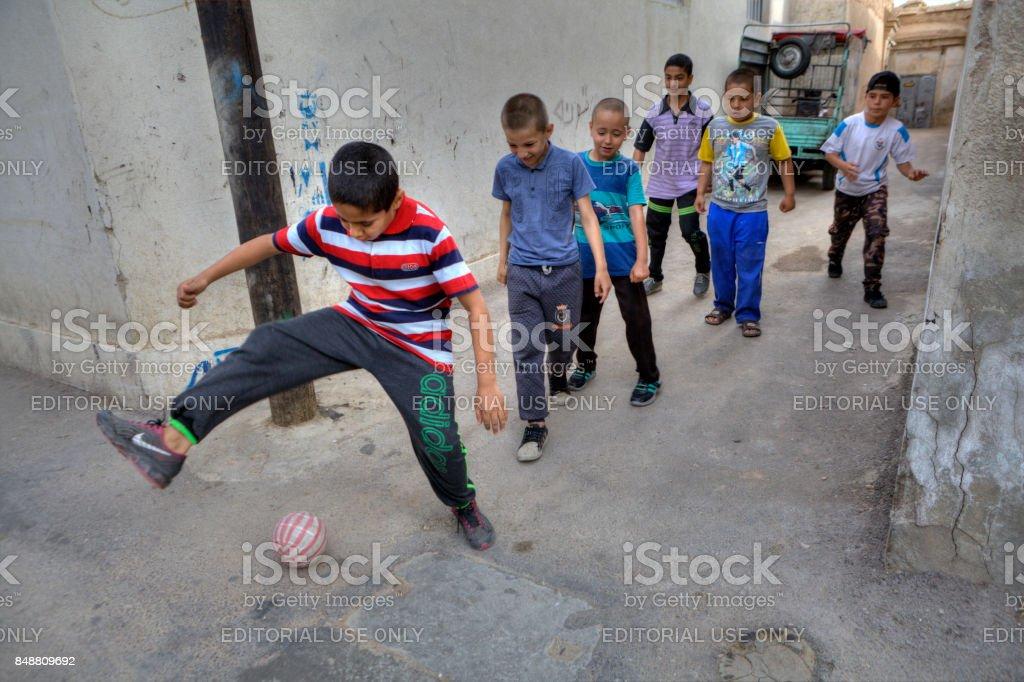 Iranian teenagers play in domestic football, Shiraz, Iran. stock photo
