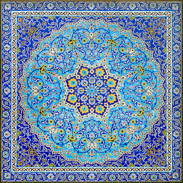 Iranian Tile Decor Geometrical islamic and  arabic style full frame tile tableau. A mosaic of mostly blue tiles with a square and circle pattern. A symmetrical wall decoration in the Golestan Palace in Tehran, Iran. The center looks like a flower. arabic style stock pictures, royalty-free photos & images