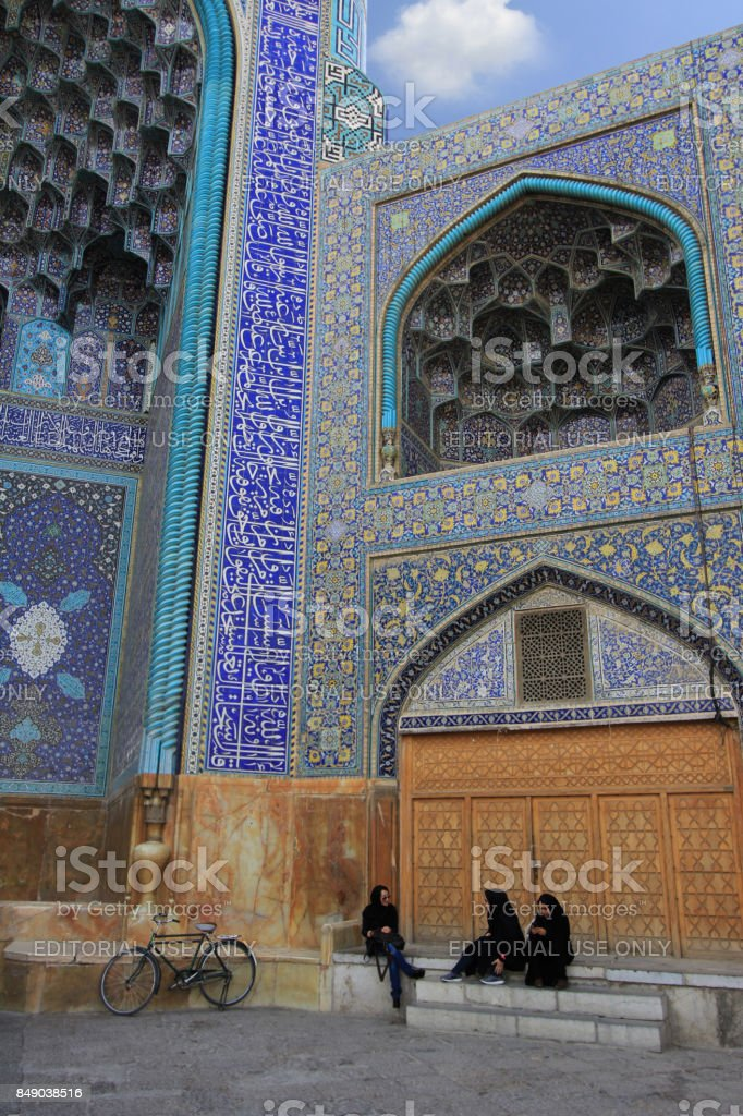 Iranian women in front of Shah Mosque (Imam Mosque) at Naghsh-e Jahan Square near Grand Bazaar in Isfahan,Iran. stock photo