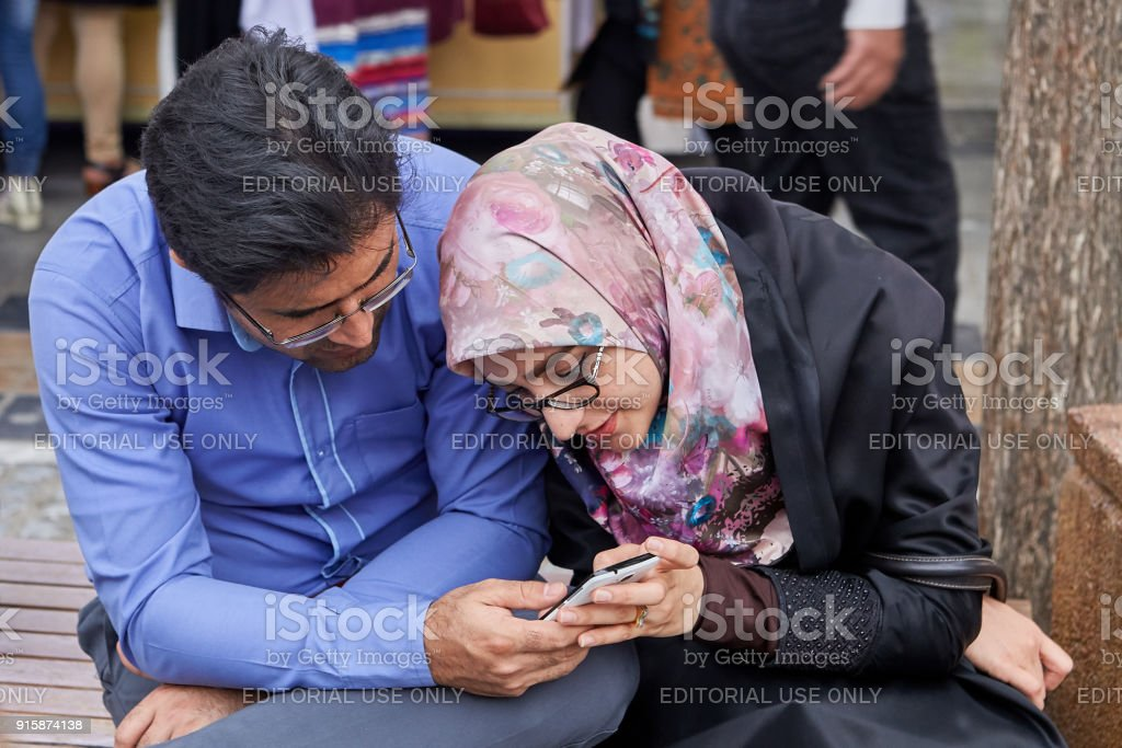 Iranians sit on street of Shahre Rey area, Tehran, Iran. stock photo