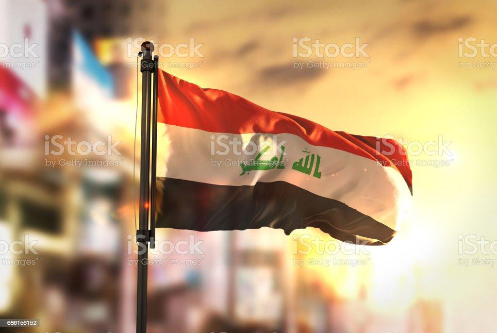 Iraq Flag Against City Blurred Background At Sunrise Backlight - foto de stock