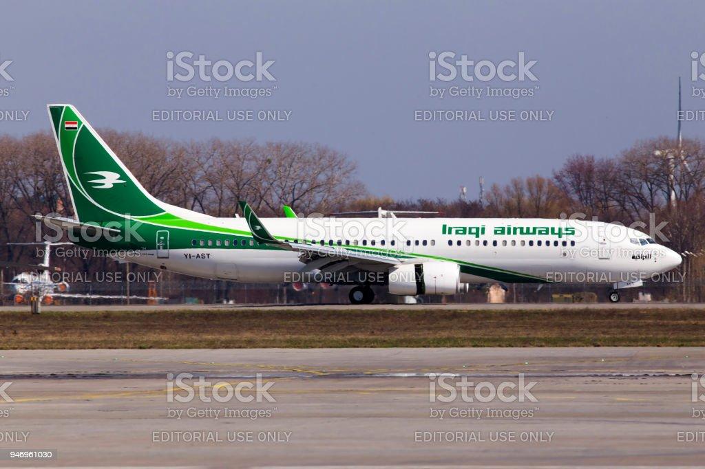YI-AST Iraqi Airways Boeing 737-800 aircraft landing on the runway stock photo