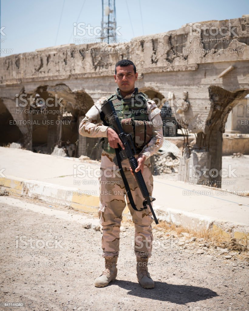 Iraqi solider at Nabi Yunus shrine ruins in Mosul, Iraq stock photo