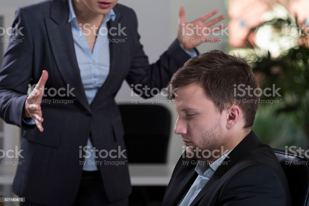 Irate femle boss stock photo