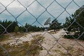 istock Irbene radio telescope in Latvia, behind the fence 1290507442