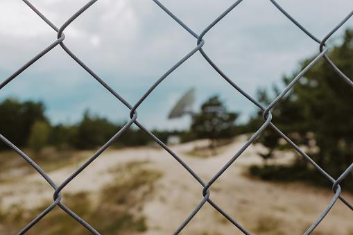 Irbene radio telescope in Latvia, behind the fence