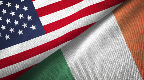 Ireland and United States two flags together realations textile cloth fabric texture stock photo