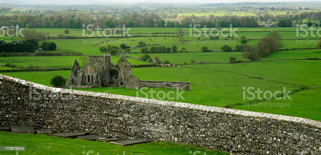 Ireland country scape with castle ruins and wall stock photo