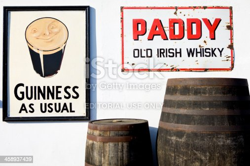 Ardfert, Ireland - March 02, 2012: Alcohol signs and old type barrels outside of a pub in the village of Ardfert, near Tralee, county Kerry, in South West of Ireland